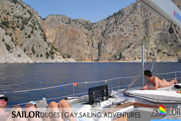 Gay nude sailing on deck. Gay naturist sailing. Gay active sailing holidays. Gay nude travelling. Gay nude skipper.