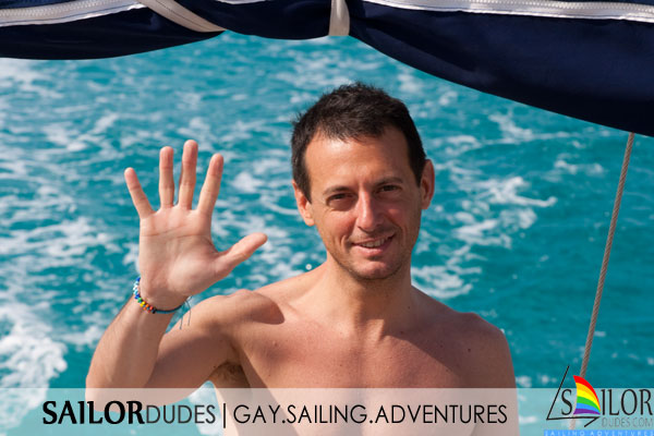 Gay sailing boy waving