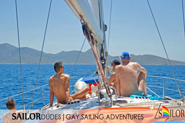 Naked gay guys sailing on deck
