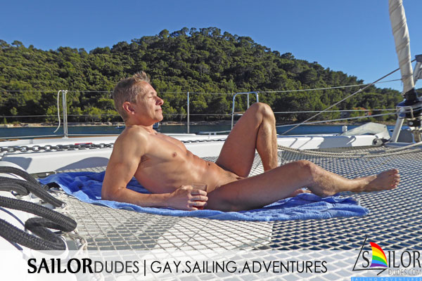 Gay naked guy sailing catamaran Croatia