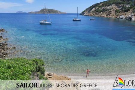 Greek bay in sporades with blue water and naked gay on beach