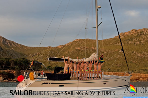 Naked gay guys waving on sailing yacht in Mallorca