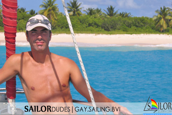 Gay sailing bvi - guy on bow