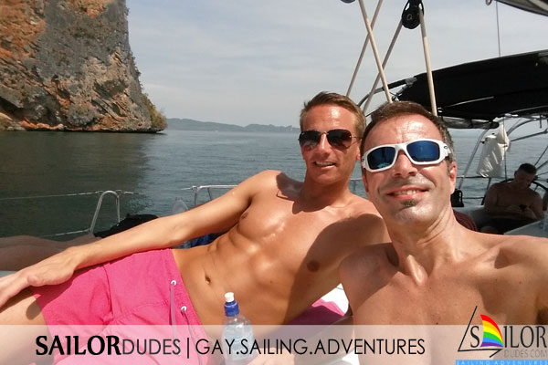 Gay sailing program relax on deck
