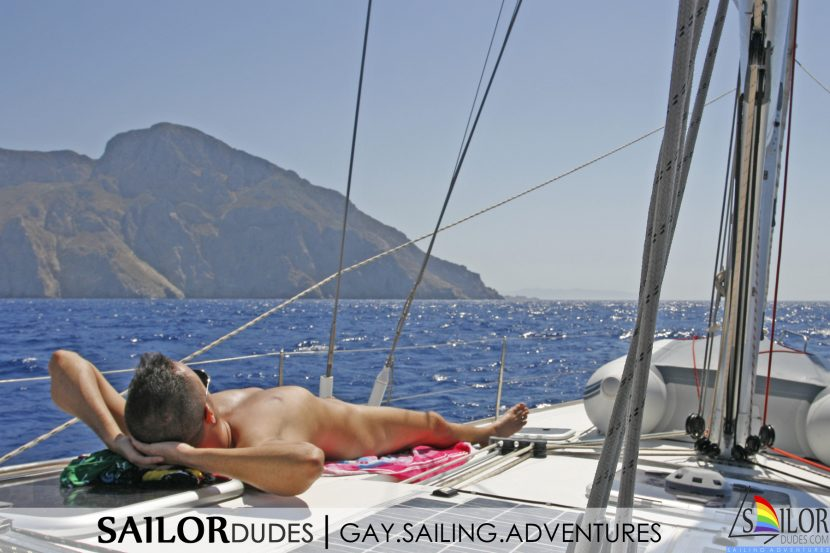 Gay guy laying on sailing yacht deck